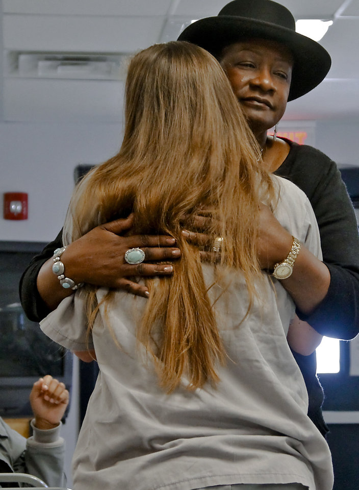 Marsha Travis, an Oklahoma City volunteer from The Gate Church, hugs an inmate during Travis� Bible study session at Mabel Bassett Correctional Center.