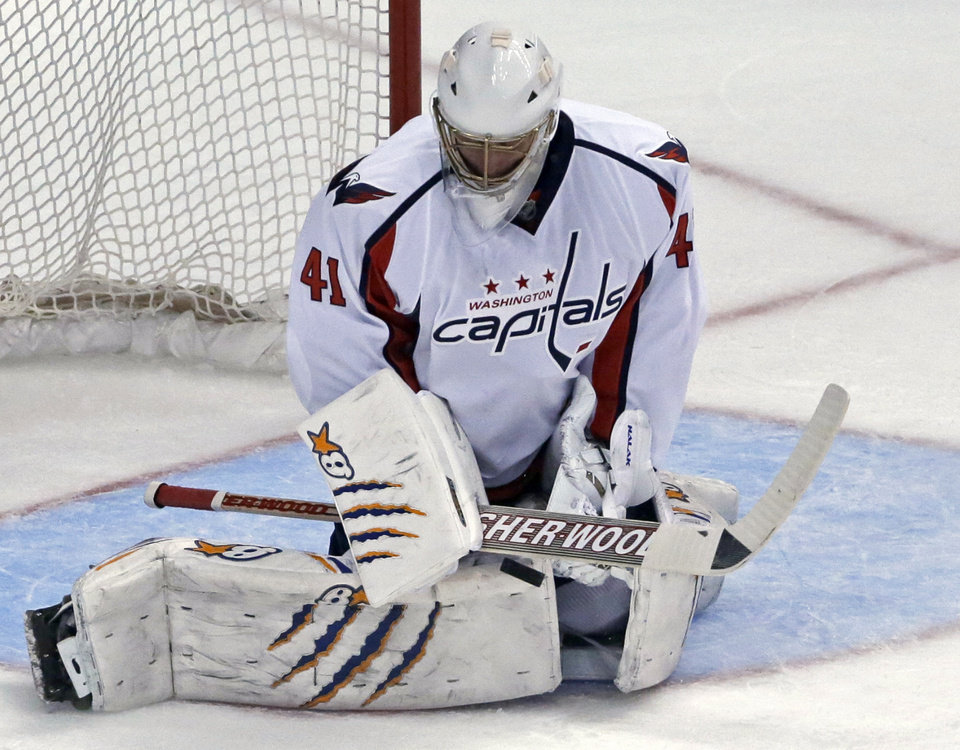 Photo - Washington Capitals goalie Jaroslav Halak, of Slovakia, blocks a shot from the Anaheim Ducks during the second period of an NHL hockey game Tuesday, March 18, 2014, in Anaheim, Calif. (AP Photo/Reed Saxon)