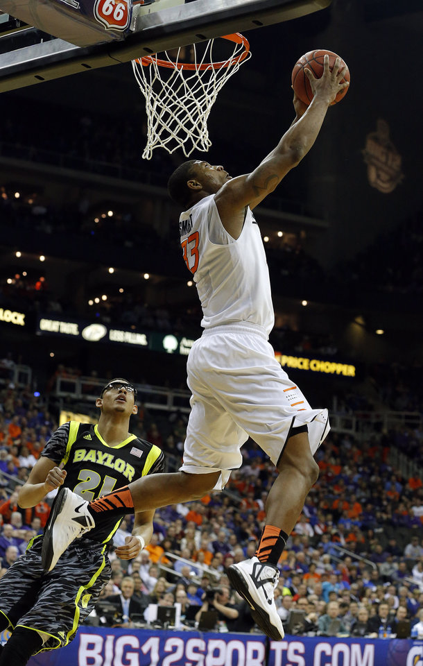 Oklahoma State's Marcus Smart (33) dunks in front of Baylor's Isaiah Austin (21) during the Phillips 66 Big 12 Men's basketball championship tournament game between Oklahoma State University and Baylor at the Sprint Center in Kansas City, Thursday, March 14, 2013. Photo by Sarah Phipps, The Oklahoman