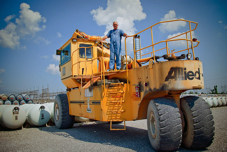 Photo - This June 2012 photo provided by the United States Enrichment Corporation shows Ronnie Kineman, a member of USEC's cylinder handling crew which operated heavy machinery to move 10- and 14-ton cylinders of solid uranium onto trailers at the Paducah Gaseous Diffusion Plant in Paducah, Ky. In May 2013, plant operators announced they were shutting it down. They laid off 160 workers at the end of last week and expect to let another 100 go in October. Altogether, it looks like more than 1,000 workers will be left without jobs, losing generous salaries that will be nearly impossible to match elsewhere in the region. (AP Photo/USEC, Ira Wexler)