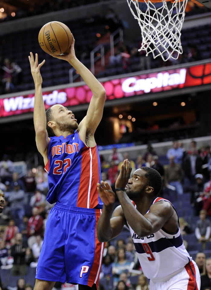 Photo - Detroit Pistons forward Tayshaun Prince (22) goes to the basket against Washington Wizards forward Martell Webster (9) during the first half of an NBA basketball game, Saturday, Dec. 22, 2012, in Washington. (AP Photo/Nick Wass)