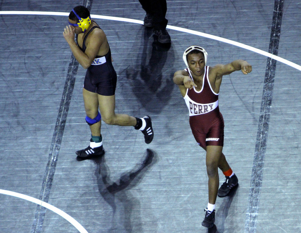 Photo - Perry's Jamaree Swan celebrates his win over Newkirk's Eric Juanes in the 120-pound match during the state wrestling championships at the State Fair Arena in Oklahoma City, Saturday, Feb. 25, 2012. Photo by Sarah Phipps, The Oklahoman