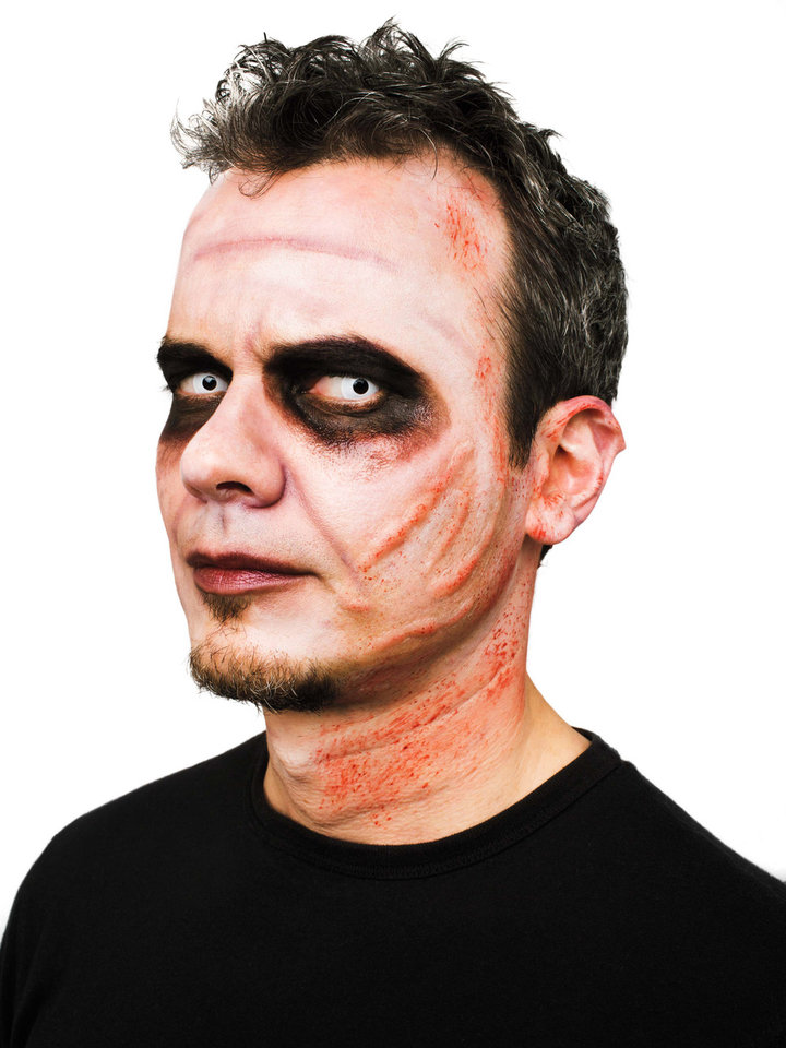"""Photo - This photo provided by courtesy of the Martha Stewart Halloween special issue shows a Zombie costume, with makeup, including white greasepaint, and 3D scars combined to create a convincing zombie look. See the special issue """"Martha Stewart Halloween"""" for more details. With supplies on hand and help from Hollywood-inspired special effects, a Halloween costume can be assembled in a snap. (AP Photo/Copyright 2013 Martha Stewart Halloween Special Issue, Glenn Glasser) **MANDATORY CREDIT** ORG XMIT: NYLS459"""