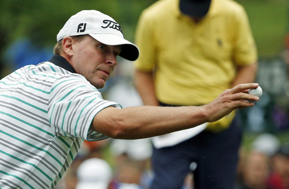 Photo - Steve Stricker reacts after making a birdie on the 14th hole during the second round of the PGA Championship golf tournament at Valhalla Golf Club on Friday, Aug. 8, 2014, in Louisville, Ky. (AP Photo/Mike Groll)