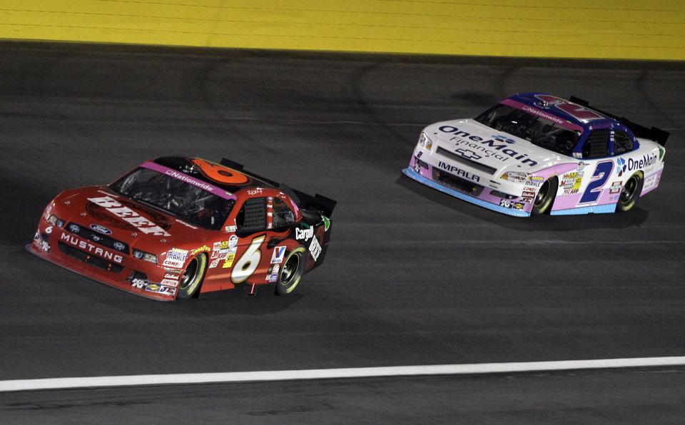 Ricky Stenhouse Jr (6) races past Elliott Sadler (2) during the NASCAR Dollar General 300 Nationwide Series auto race in Concord, N.C., Friday, Oct. 12, 2012. (AP Photo/Chuck Burton)