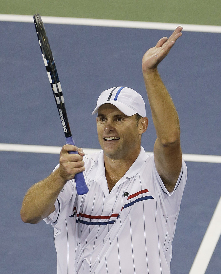 Photo -   Andy Roddick reacts after winning his match against Australia's Bernard Tomic in the third round of play at the 2012 US Open tennis tournament, Friday, Aug. 31, 2012, in New York. (AP Photo/Mike Groll)