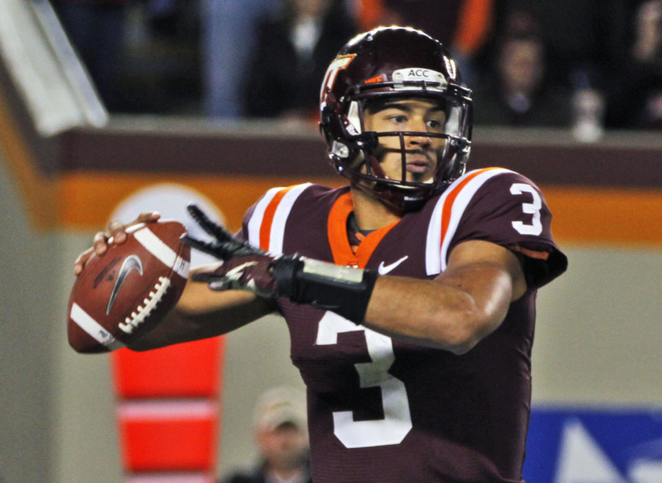 Photo -   Virginia Tech quarterback Logan Thomas looks for a receiver during the first half of an NCAA college football game against Florida State in Blacksburg, Va., Thursday, Nov. 8, 2012. (AP Photo/Steve Helber)