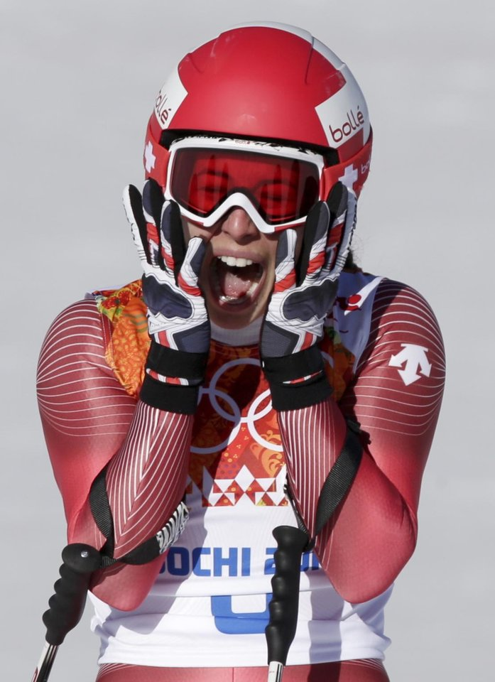 Photo - Switzerland's Dominique Gisin reacts after finishing in the women's downhill at the Sochi 2014 Winter Olympics, Wednesday, Feb. 12, 2014, in Krasnaya Polyana, Russia. (AP Photo/Gero Breloer)