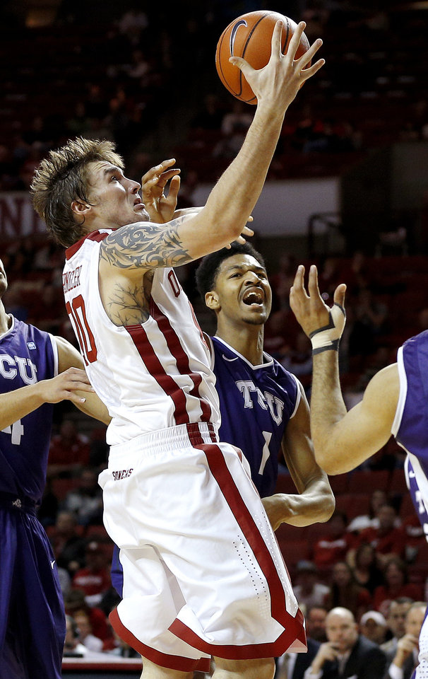 Photo - Oklahoma's Ryan Spangler reaches for a rebound beside TCU's Karviar Shepherd (1) during an NCAA college basketball game between the University of Oklahoma (OU) and Texas Christian University (TCU) at Lloyd Noble Center, Wednesday, Jan. 22, 2014.  Oklahoma won 77-69. Photo by Bryan Terry, The Oklahoman