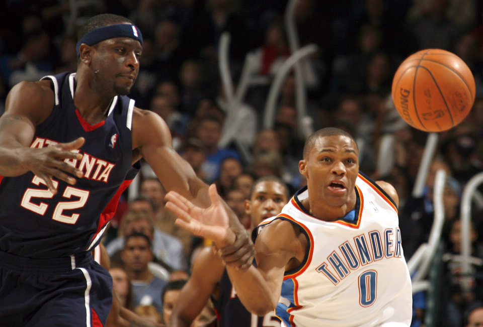 Oklahoma City\'s Russell Westbrook (0) and Atlanta\'s Flip Murray (22) try to catch a loose ball during the second half of the NBA basketball game between Oklahoma City Thunder and the Atlanta Hawks, Sunday, Nov. 9, 2008, at the Ford Center, Oklahoma City. PHOTO BY SARAH PHIPPS, THE OKLAHOMAN ORG XMIT: KOD