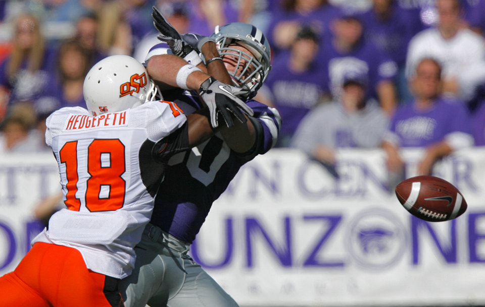 Photo - Oklahoma State's Devin Hedgepeth (18) breaks up a pass for Kansas State's Travis Tannahill (80) during the second half of the college football game between the Oklahoma State University Cowboys (OSU) and the Kansas State University Wildcats (KSU) on Saturday, Oct. 30, 2010, in Manhattan, Kan.   Photo by Chris Landsberger, The Oklahoman