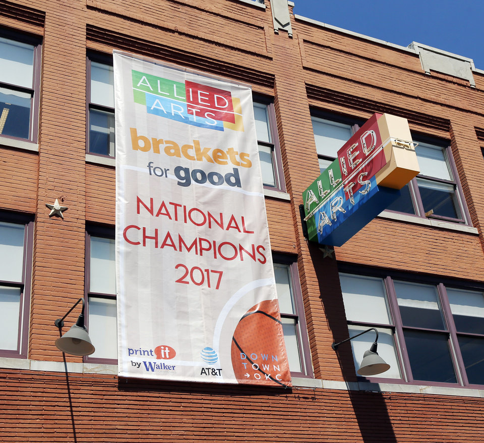 Photo -  A banner hanging at 1015 N Broadway, the location of the Allied Arts offices, announces Allied Arts' Brackets for Good Championship win. [PHOTO BY NATE BILLINGS]