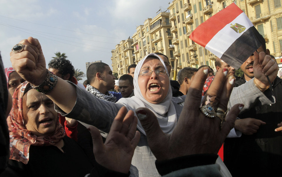 Photo - An Egyptian shouts anti-Mohammed Morsi slogans as she waves an Egyptian flag during a protest at Tahrir Square, the focal point of Egyptian uprising, in Cairo, Egypt, Friday, Jan. 4, 2013. (AP Photo/Amr Nabil)