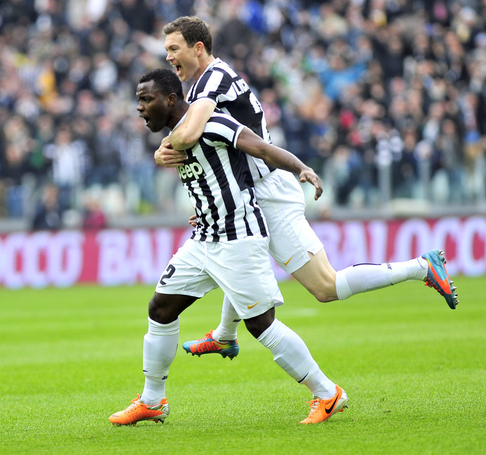 Photo - Juventus defender Kwadwo Asamoah, of Ghana, left, celebrates with his teammate Stephan Lichtsteiner of Switzerland, after he scored during a Serie A soccer match between Juventus and Chievo Verona, at the Juventus stadium, in Turin, Italy, Sunday, Feb. 16, 2014. (AP Photo/Massimo Pinca)