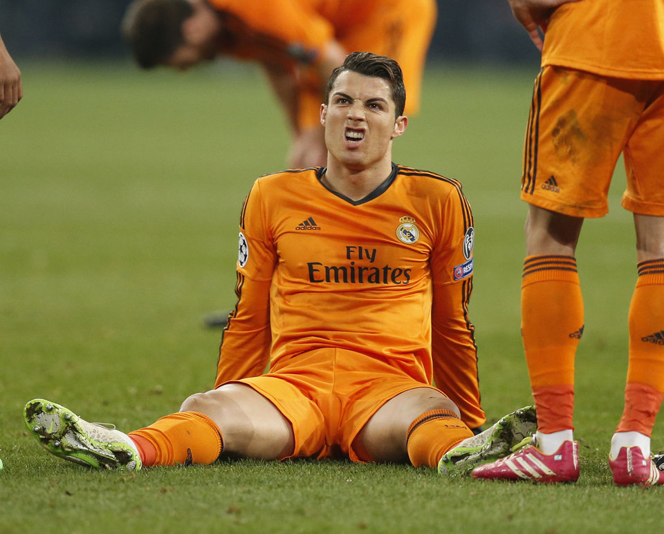 Photo - Real's Cristiano Ronaldo sits on the pitch  during the Champions League round of the last 16 first leg soccer match between Schalke 04 and Real Madrid in Gelsenkirchen, Germany, Wednesday, Feb.26,2014. (AP Photo/Frank Augstein)