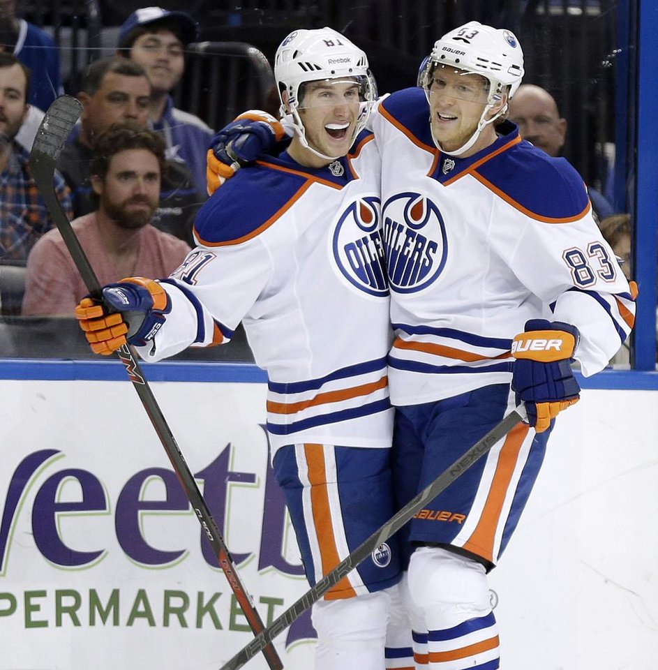 Taylor Fedun, left, pictured after scoring a goal with Edmonton last November has 28 points in 51 games with the Barons this season. AP Photo
