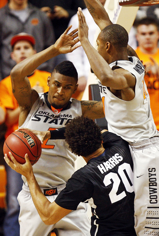 Oklahoma State\'s Le\'Bryan Nash (2) and Kamari Murphy (21) defend Gonzaga\'s Elias Harris (20) during a men\'s college basketball game between Oklahoma State University (OSU) and Gonzaga at Gallagher-Iba Arena in Stillwater, Okla., Monday, Dec. 31, 2012. Gonzaga won, 69-68. Photo by Nate Billings, The Oklahoman