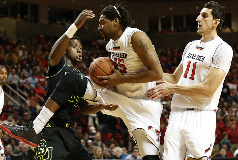 Photo - Texas Tech's Aaron Ross (15) grabs away a rebound from Baylor's Royce O'Neale as teammate Dejan Kravic(11) looks on during an NCAA college basketball game in Lubbock, Texas, Wednesday, Jan, 15, 2014. (AP Photo/Lubbock Avalanche-Journal, Tori Eichberger) ALL LOCAL TV OUT