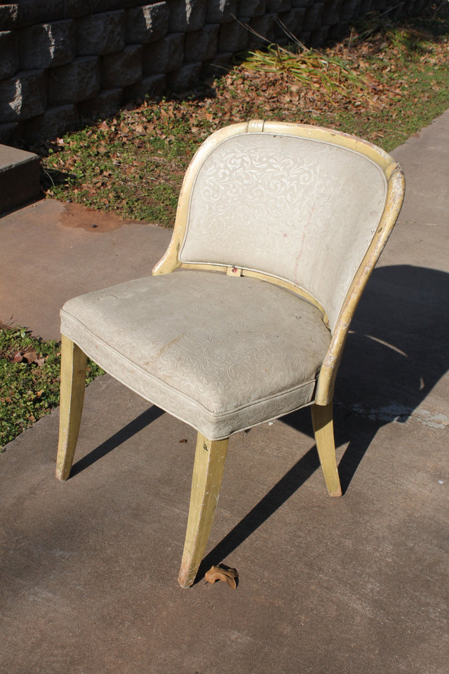 Photo - You can find old furniture to refinish and reupholster at garage sales, thrift stores, even discards on the side of the street. Use the existing fabric as a template for your new fabric. Photo provided.