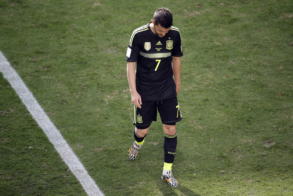 Photo - Spain's David Villa walks off the pitch after being replaced, during the group B World Cup soccer match between Australia and Spain at the Arena da Baixada in Curitiba, Brazil, Monday, June 23, 2014. (AP Photo/Michael Sohn)