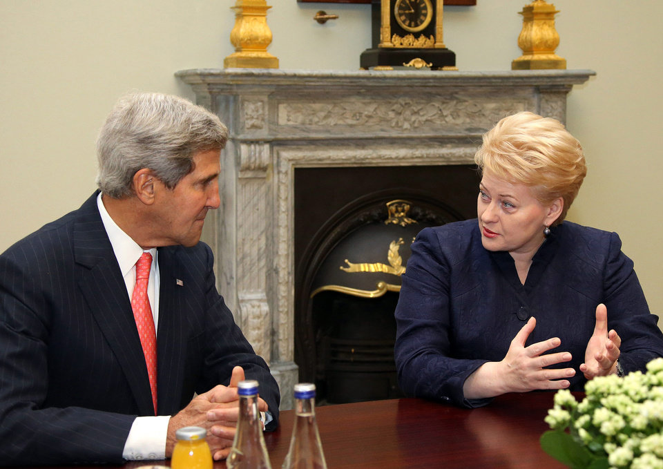 Photo - This photo made available by the Lithuanian Presidential Press Service shows United States Secretary of State John Kerry, left, and Lithuania's President Dalia Grybauskaite speaking prior to their meeting at the President palace in Vilnius, Lithuania, Saturday, Sept. 7, 2013. Kerry is in Europe courting international support for a possible U.S. strike on the Syrian regime for its alleged use of chemical weapons.  (AP Photo/Presidential Press Service, Dzoja Borysaite)