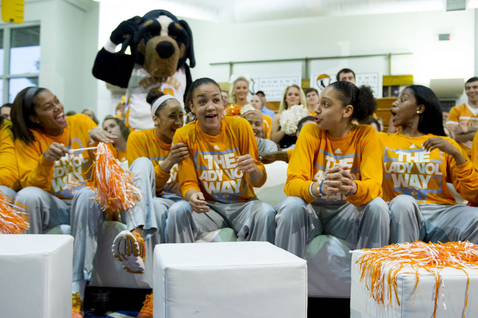 Photo - Tennessee's Andraya Carter, center, is surprised and congratulated by teammates as she was showcased on the NCAA selection show at the Women's Basketball Hall of Fame in Knoxville, Tenn. on Monday, March 17, 2014. Tennessee received a no. 1 seed in the Louisville Regional of the NCAA Tournament.  (AP Photo/The Knoxville News Sentinel, Saul Young)