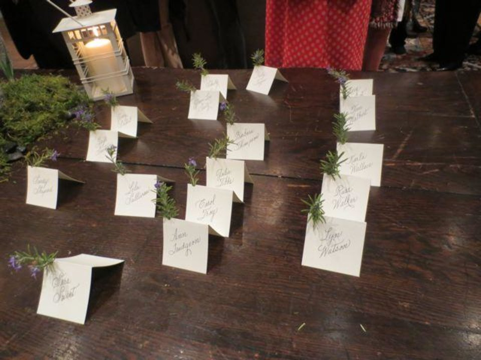 Place cards held blooming sprigs of rosemary. (Photo by Helen Ford Wallace).