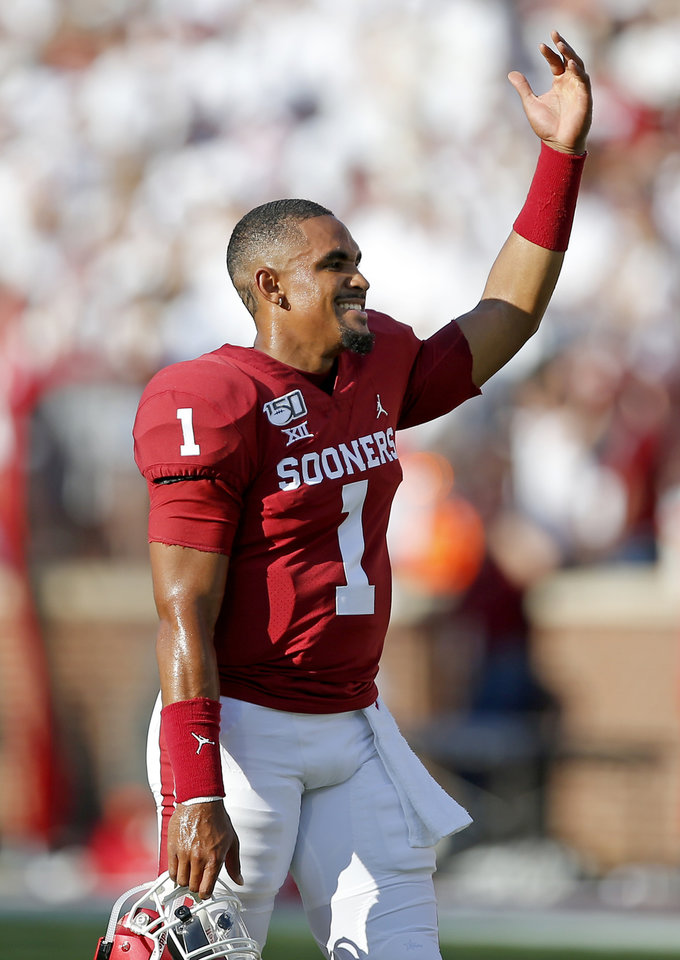 Photo - Oklahoma's Jalen Hurts (1) jesters to the crowd during a college football game between the University of Oklahoma Sooners (OU) and the Houston Cougars at Gaylord Family-Oklahoma Memorial Stadium in Norman, Okla., Sunday, Sept. 1, 2019. [Sarah Phipps/The Oklahoman]