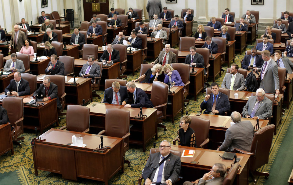 Photo - Oklahoma's legislature gathers Monday, Sep. 25, 2017,  for a special session. This photo shows representatives at their desks on the floor of the House chamber. Photo by Jim Beckel, The Oklahoman