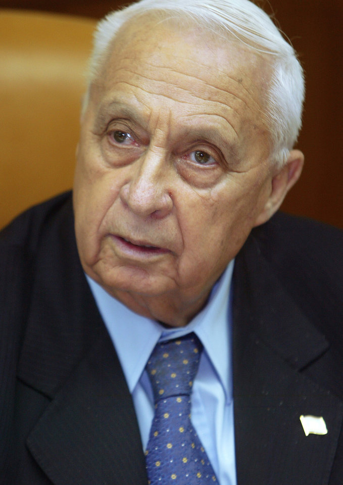 "FILE - In this Jan. 24, 2005 file photo, Israeli Prime Minister Ariel Sharon is pictured at the start of a meeting at his office, in Jerusalem. Seven years after a massive stroke removed him from office and left him in a vegetative state, comatose former Israeli Prime Minister Ariel Sharon is able to process information and has exhibited ""robust activity"" in his brain, one of the half-dozen doctors who recently tested him said Monday. (AP Photo/Brennan Linsley, File)"
