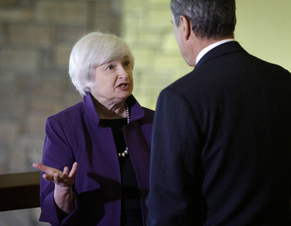 Photo - Federal Reserve Chair Janet Yellen, left, and European Central Bank President Mario Draghi speak during the Jackson Hole Economic Policy Symposium at the Jackson Lake Lodge in Grand Teton National Park near Jackson, Wyo. Friday, Aug. 22, 2014. (AP Photo/John Locher)