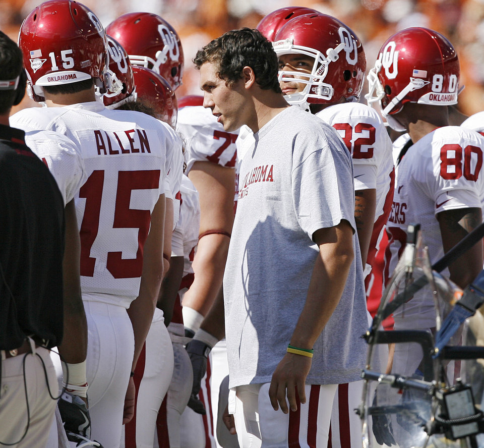 Photo - Oklahoma's Sam Bradford listens in on the offensive huddle in the second half during the Red River Rivalry college football game between the University of Oklahoma Sooners (OU) and the University of Texas Longhorns (UT) at the Cotton Bowl in Dallas, Texas, Saturday, Oct. 17, 2009. Bradford was injured in the first quarter, and never returned to the game. Photo by Chris Landsberger, The Oklahoman