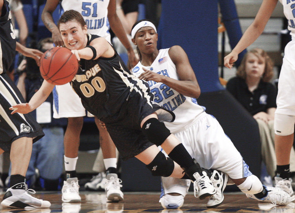 Purdue guard Jodi Howell (00) and North Carolina forward Rashanda McCants (32) try to chase down the ball in the second half of Monday's NCAA Women's Tournament game. AP PHOTO