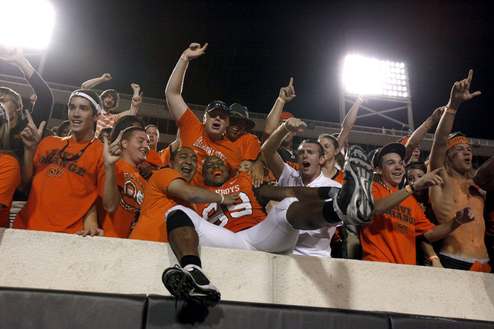Photo - OSU's Richetti Jones celebrates with fans during the college football game between the Washington State Cougars (WSU) and the Oklahoma State Cowboys (OSU) at Boone Pickens Stadium in Stillwater, Okla., Saturday, September 4, 2010. Photo by Sarah Phipps, The Oklahoman
