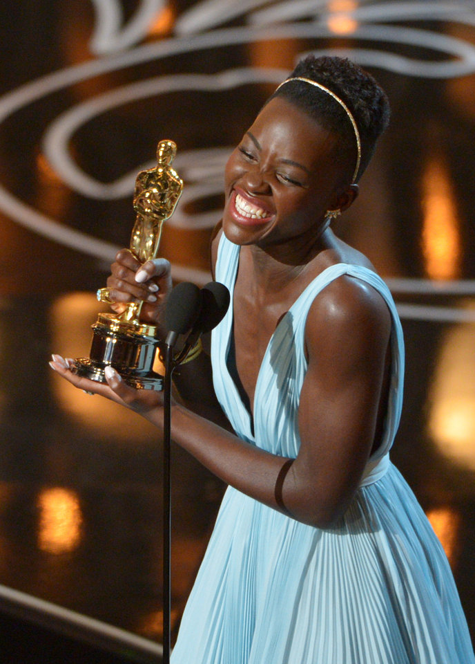 Photo - Lupita Nyong'o accepts the award for best actress in a supporting role for