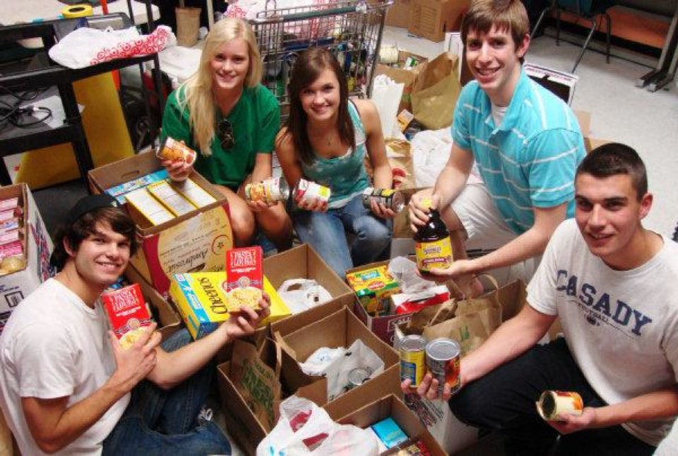 Edmond Santa Fe and North high school students recently collected more than 50 boxes of food for tornado victims. Pictured from left are Santa Fe students Cody Turner, Julie Stockton and Megan Turner, and North students Brett Holleman and Charles Anderson. PHOTO PROVIDED BY EARL KIRKPATRICK, NEWSOK.COM  <strong></strong>