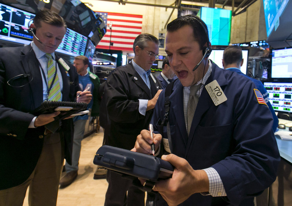 Photo - Trader Michael Zicchinolfi, right, works on the floor of the New York Stock Exchange, Friday, Oct. 25, 2013. Earnings gains from Microsoft and other big U.S. companies are pushing the stock market higher in early trading. (AP Photo/Richard Drew)