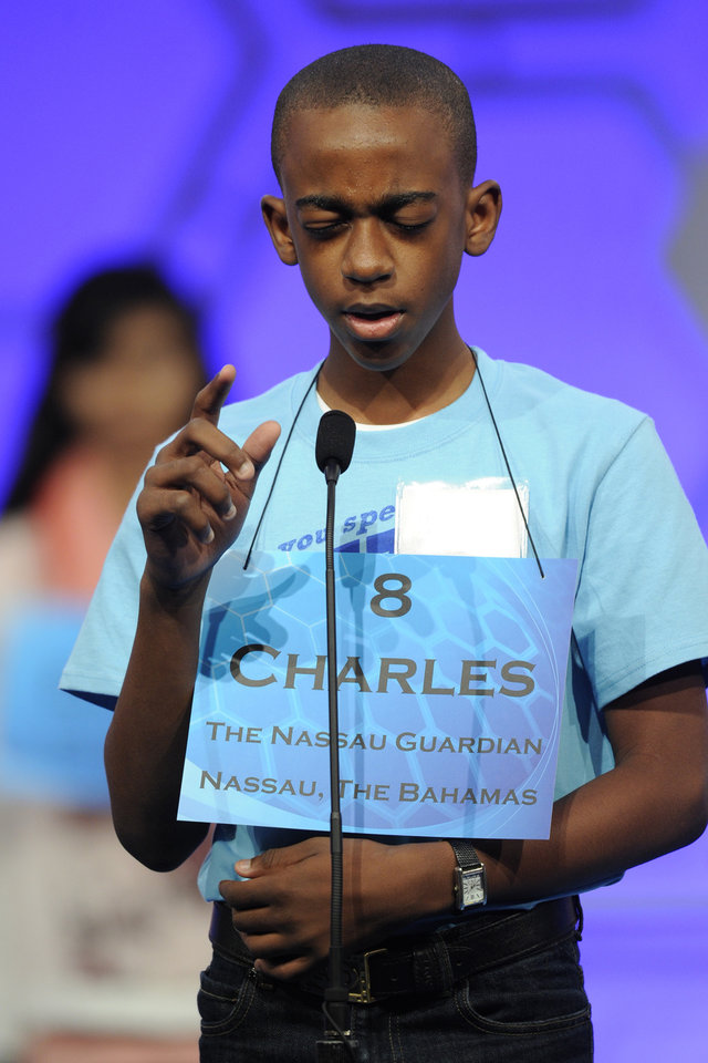 Photo - Charles Hamilton Jr., 12, of Nassau, Bahamas, spells his word during the 2015 Scripps National Spelling Bee in Oxon Hill, Md., Wednesday, May 27, 2015. (AP Photo/Cliff Owen)