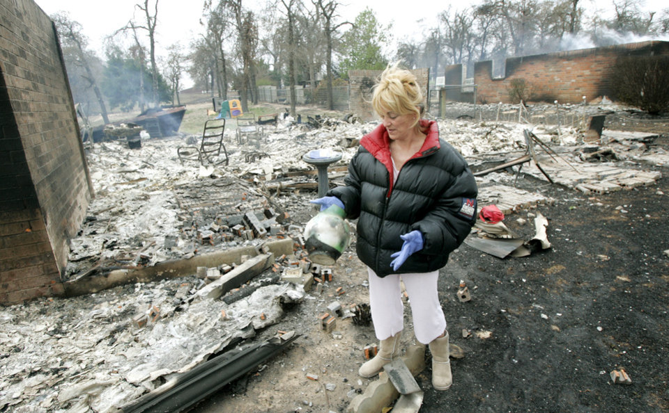 Julie Wilson found this antique pitcher as she was helping her brother clean up after his home at 14500 NE 4th  was destroyed in a wildfire in Choctaw, Oklahoma April 10, 2009.  Photo by Steve Gooch, The Oklahoman