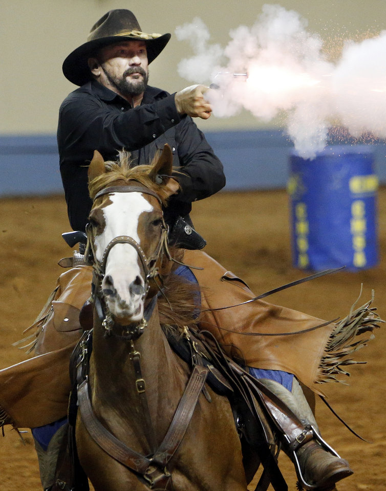 Doug Rogers, of Midland, Texas, competes in Cowboy Mounted Shooting during the Battle in the Saddle at the State Fair Park in Oklahoma City, Thursday, July 5, 2012. Photo by Nate Billings, The Oklahoman