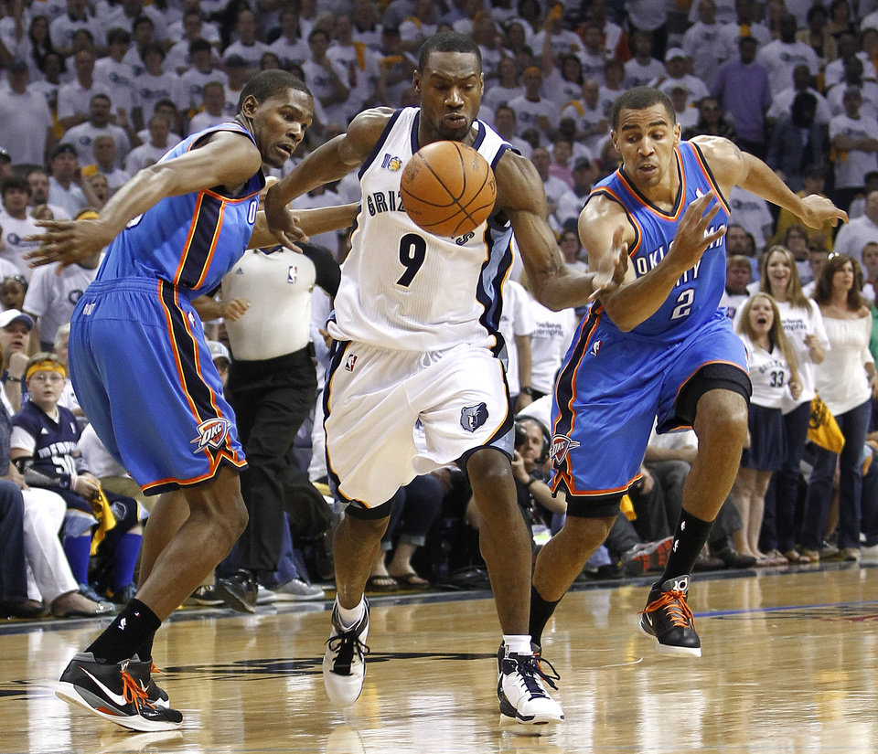 Photo - Memphis Grizzlies guard Tony Allen (9) steals the ball away from Oklahoma City Thunder forward Kevin Durant, left, and Thabo Sefolosha (2), of Switzerland, during the first half of Game 6 of a second-round NBA basketball playoff series on Friday, May 13, 2011, in Memphis, Tenn. (AP Photo/Wade Payne)