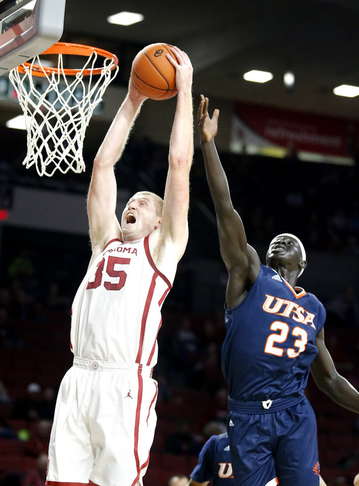 Photo - Oklahoma's Brady Manek (35) goes up for a basketa as UTSA's Atem Bior (23) defends during the college basketball game between the University of Oklahoma and the UTSA Roadrunners at the Lloyd Noble Center in Norman, Okla.,  Tuesday, Nov. 5, 2019.  [Sarah Phipps/The Oklahoman]
