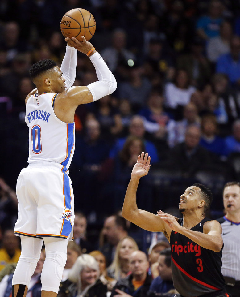 Photo - Oklahoma City's Russell Westbrook (0) shoots over Portland's CJ McCollum (3) in the first quarter during an NBA basketball game between the Portland Trail Blazers and the Oklahoma City Thunder at Chesapeake Energy Arena in Oklahoma City, Monday, Feb. 11, 2019. Photo by Nate Billings, The Oklahoman