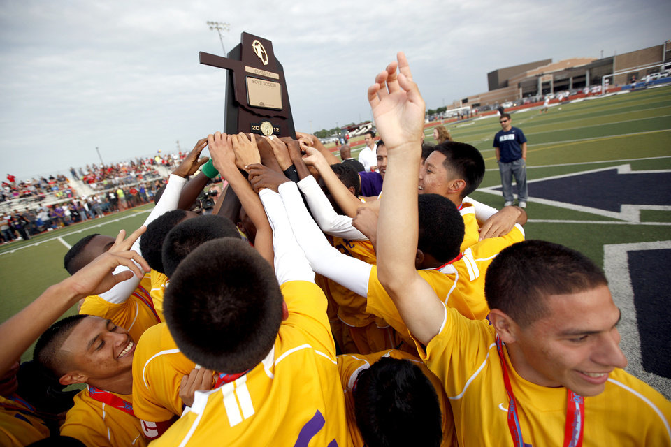 CLASS 5A HIGH SCHOOL SOCCER / STATE TOURNAMENT / CELEBRATION: Northwest Classen celebrates their win in the boys 5A soccer state championship game over Cascia Hall at Edmond North High School in Edmond, Okla., Saturday, May 12, 2012. Photo by Sarah Phipps, The Oklahoman