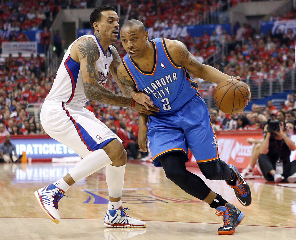 Photo - Oklahoma City's Caron Butler (2) drive to the basket as Los Angeles' Matt Barnes (22) defends during Game 3 of the Western Conference semifinals in the NBA playoffs between the Oklahoma City Thunder and the Los Angeles Clippers at the Staples Center in Los Angeles, Friday, May 9, 2014. Photo by Nate Billings, The Oklahoman
