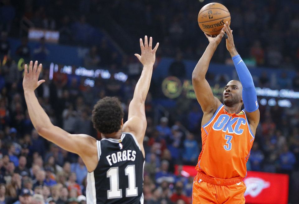 Photo - Oklahoma City's Chris Paul (3) shoots over San Antonio's Bryn Forbes (11) during an NBA basketball game between the Oklahoma City Thunder and the San Antonio Spurs at Chesapeake Energy Arena in Oklahoma City, Sunday, Feb. 23, 2020. Oklahoma city won 131-103. [Bryan Terry/The Oklahoman]