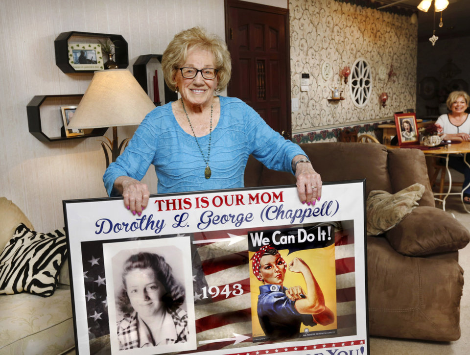 Photo -  Dorothy George holds up a poster that her children made for her. It honors George for her work as a riveter at Douglas Aircraft during World War II. [Photo by Jim Beckel, The Oklahoman]