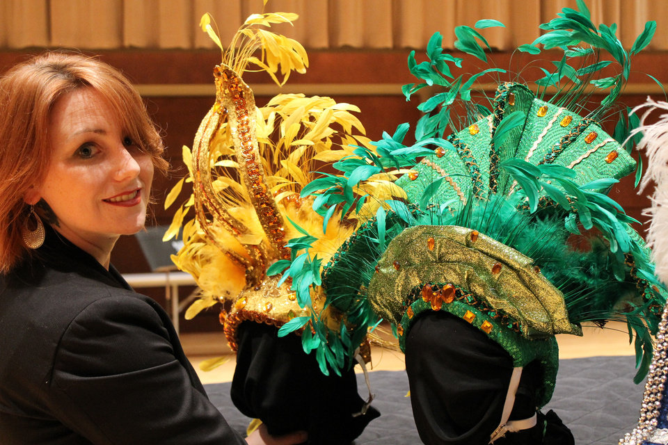 Photo - Oklahoma City University Resident Costume Designer and Assistant Professor Ashley Bellet poses with some of the headdresses she hand made for last year's Oklahoma Senior Follies. Photo by Heather Warlick, The Oklahoman.