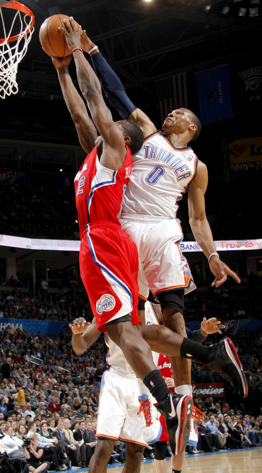 Oklahoma City's Russell Westbrook (0) blocks the shot of Los Angeles' Eric Bledsoe (12) during the NBA basketball game between the Oklahoma City Thunder and the Los Angeles Clippers at the Oklahoma CIty Arena, Tuesday, Feb. 22, 2011.  Photo by Bryan Terry, The Oklahoman