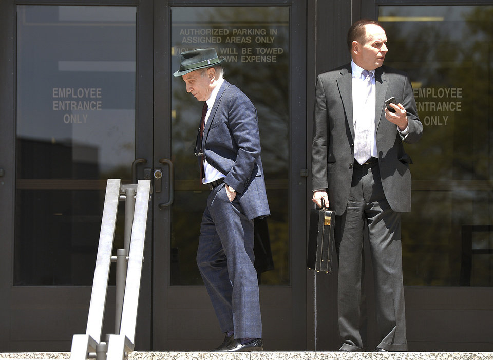 Photo - Singer Paul Simon, left, leaves Norwalk Superior Court with his attorney Stephen Hayes after a hearing Monday April 28, 2014 in Norwalk, Conn. Simon and his wife Edie Brickell were arrested Saturday on disorderly conduct charges by officers investigating a family dispute at their home in New Canaan.  (AP Photo/The Hour, Alex von Kleydorff)